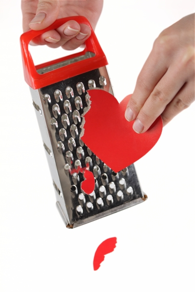 884307-female-hands-rubbing-heart-on-a-kitchen-grater